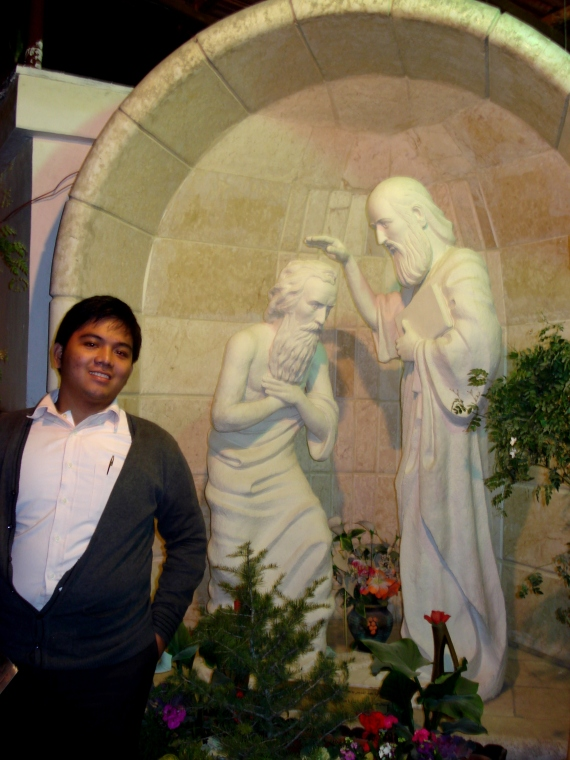 beside a statue that shows St. Ananias baptizing St. Paul