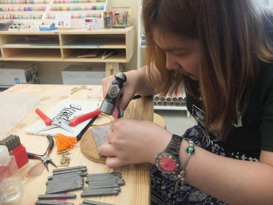 handstamping each letter (photo courtesy of the Pulseras by Kim Facebook page)